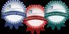 Vista en miniatura de 3 insignias de colores con el logo de la ULPGC
